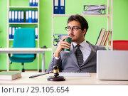 Купить «Young handsome lawyer working in the office», фото № 29105654, снято 22 мая 2018 г. (c) Elnur / Фотобанк Лори