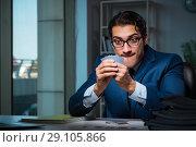 Купить «Young business playing cards late in office», фото № 29105866, снято 9 октября 2017 г. (c) Elnur / Фотобанк Лори