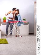 Купить «Young woman doing ironing for her husband», фото № 29106058, снято 27 июня 2018 г. (c) Elnur / Фотобанк Лори