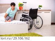 Купить «Young handsome disabled man recovering at home», фото № 29106162, снято 28 июня 2018 г. (c) Elnur / Фотобанк Лори