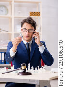 Купить «Young lawyer playing chess to train his court strategy and tacti», фото № 29106510, снято 31 июля 2018 г. (c) Elnur / Фотобанк Лори