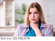 Купить «Young woman suffering from sore throat pain», фото № 29106674, снято 30 марта 2018 г. (c) Elnur / Фотобанк Лори