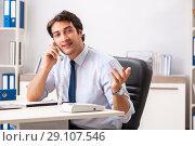 Купить «Young call center operator speaking on phone», фото № 29107546, снято 3 июля 2018 г. (c) Elnur / Фотобанк Лори