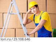 Купить «Man contractor working with boxes delivery», фото № 29108646, снято 4 июня 2018 г. (c) Elnur / Фотобанк Лори