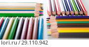 colored pencils lying in rows. Стоковое фото, фотограф Татьяна Яцевич / Фотобанк Лори