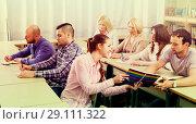 Купить «Professionals taking notes at training session», фото № 29111322, снято 17 декабря 2018 г. (c) Яков Филимонов / Фотобанк Лори