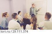 Купить «Medical male lecturer answering near whiteboard», фото № 29111374, снято 5 октября 2017 г. (c) Яков Филимонов / Фотобанк Лори