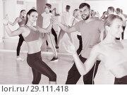 Купить «dancing couples of men and women learning swing», фото № 29111418, снято 9 октября 2017 г. (c) Яков Филимонов / Фотобанк Лори