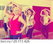 Купить «Adults dancing in dance studio», фото № 29111426, снято 21 сентября 2018 г. (c) Яков Филимонов / Фотобанк Лори