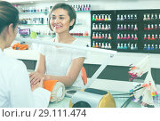 Купить «friendly female manicurist filing and shaping nails in beauty salon», фото № 29111474, снято 28 апреля 2017 г. (c) Яков Филимонов / Фотобанк Лори