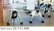 Купить «Men and women practicing boxing punches», фото № 29111498, снято 5 мая 2017 г. (c) Яков Филимонов / Фотобанк Лори