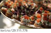 Купить «Snack on the tray On a sunny day on a white tablecloth», видеоролик № 29111778, снято 9 августа 2018 г. (c) Aleksejs Bergmanis / Фотобанк Лори