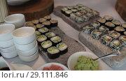 Купить «Sushi Snack on the tray On a sunny day on a white tablecloth», видеоролик № 29111846, снято 9 августа 2018 г. (c) Aleksejs Bergmanis / Фотобанк Лори