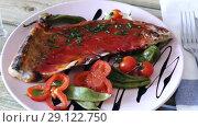 Купить «Lamb ribs with hot tomato sauce, roasted chili pepper, balsamic and fresh vegetables», видеоролик № 29122750, снято 28 августа 2018 г. (c) Яков Филимонов / Фотобанк Лори