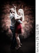 Купить «Young and sexy couple dances Caribbean Salsa», фото № 29122878, снято 22 ноября 2019 г. (c) Игорь Бородин / Фотобанк Лори