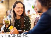 Купить «woman with friends drinking cocktail at restaurant», фото № 29123442, снято 19 ноября 2016 г. (c) Syda Productions / Фотобанк Лори