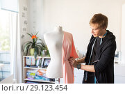 Купить «fashion designer with dummy making dress at studio», фото № 29123454, снято 28 июня 2017 г. (c) Syda Productions / Фотобанк Лори