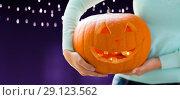 Купить «close up of woman holding halloween pumpkin», фото № 29123562, снято 17 сентября 2014 г. (c) Syda Productions / Фотобанк Лори