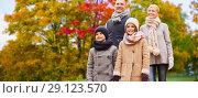 Купить «happy family over autumn park background», фото № 29123570, снято 12 октября 2014 г. (c) Syda Productions / Фотобанк Лори