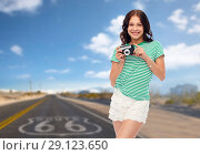Купить «teenage girl with vintage film camera on route 66», фото № 29123650, снято 30 июня 2018 г. (c) Syda Productions / Фотобанк Лори