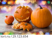 Купить «close up of halloween pumpkins on table», фото № 29123654, снято 15 сентября 2017 г. (c) Syda Productions / Фотобанк Лори