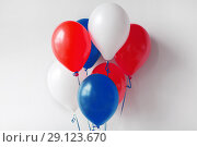 Купить «party decoration with red, white and blue balloons», фото № 29123670, снято 6 июля 2017 г. (c) Syda Productions / Фотобанк Лори