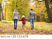 Купить «happy family walking at autumn park», фото № 29123674, снято 19 октября 2017 г. (c) Syda Productions / Фотобанк Лори