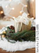 Купить «christmas gift and fir wreath with cones and balls», фото № 29123686, снято 15 ноября 2017 г. (c) Syda Productions / Фотобанк Лори