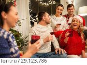 Купить «friends celebrating christmas and drinking wine», фото № 29123786, снято 17 декабря 2017 г. (c) Syda Productions / Фотобанк Лори