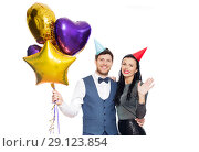 Купить «happy couple with party caps and balloons», фото № 29123854, снято 3 марта 2018 г. (c) Syda Productions / Фотобанк Лори