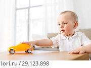 Купить «baby boy playing with toy car at home», фото № 29123898, снято 12 мая 2018 г. (c) Syda Productions / Фотобанк Лори