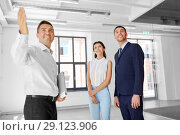 Купить «realtor showing new office room to customers», фото № 29123906, снято 8 июня 2018 г. (c) Syda Productions / Фотобанк Лори