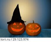 Купить «close up of halloween pumpkins on table», фото № 29123974, снято 17 сентября 2014 г. (c) Syda Productions / Фотобанк Лори