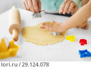 Купить «mother and daughter making cookies at home», фото № 29124078, снято 20 октября 2017 г. (c) Syda Productions / Фотобанк Лори