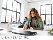 Купить «creative woman working on user interface at office», фото № 29124162, снято 1 апреля 2018 г. (c) Syda Productions / Фотобанк Лори