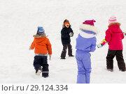Купить «happy little kids playing outdoors in winter», фото № 29124334, снято 10 февраля 2018 г. (c) Syda Productions / Фотобанк Лори