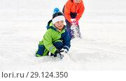 Купить «happy little kids playing outdoors in winter», фото № 29124350, снято 10 февраля 2018 г. (c) Syda Productions / Фотобанк Лори