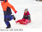 girls with sled having fun outdoors in winter. Стоковое фото, фотограф Syda Productions / Фотобанк Лори