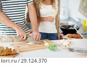Купить «couple cooking food and drinking wine at home», фото № 29124370, снято 19 октября 2017 г. (c) Syda Productions / Фотобанк Лори