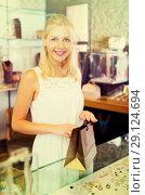 Купить «girl customer in bijouterie shop», фото № 29124694, снято 10 декабря 2019 г. (c) Яков Филимонов / Фотобанк Лори