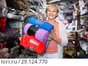 Купить «Adult female buyer choosing colour plaids in the textile store», фото № 29124770, снято 29 ноября 2017 г. (c) Яков Филимонов / Фотобанк Лори