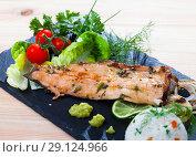 Купить «Grilled trout fillet with rice, vegetables, greens», фото № 29124966, снято 22 октября 2018 г. (c) Яков Филимонов / Фотобанк Лори