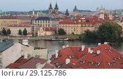 Купить «Вид сверху на город Прага, крыши домов и здания на набережной реки Влтава», видеоролик № 29125786, снято 19 сентября 2018 г. (c) Яна Королёва / Фотобанк Лори