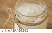 Купить «close up of yogurt or sour cream in glass jar», видеоролик № 29126962, снято 21 августа 2018 г. (c) Syda Productions / Фотобанк Лори