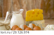 Купить «chicken eggs, milk, sour cream and cottage cheese», видеоролик № 29126974, снято 21 августа 2018 г. (c) Syda Productions / Фотобанк Лори
