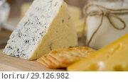 Купить «close up of cheese, crackers and butter on table», видеоролик № 29126982, снято 21 августа 2018 г. (c) Syda Productions / Фотобанк Лори