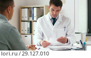 Купить «doctor writing prescription for patient at clinic», видеоролик № 29127010, снято 14 сентября 2018 г. (c) Syda Productions / Фотобанк Лори