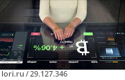 Купить «woman with bitcoin projection on interactive panel», видеоролик № 29127346, снято 20 октября 2018 г. (c) Syda Productions / Фотобанк Лори