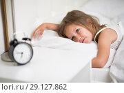 Купить «girl sleeps in bed», фото № 29127862, снято 19 мая 2018 г. (c) Типляшина Евгения / Фотобанк Лори