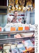 Купить «Smiling man seller showing sorts of meat», фото № 29128042, снято 2 января 2017 г. (c) Яков Филимонов / Фотобанк Лори